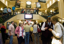 Kim Raff | The Salt Lake Tribune People gather in the lobby at a sold out show of