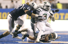 Chris Detrick  |  The Salt Lake Tribune Ohio Bobcats running back Donte Harden (8) is tackled by Utah State Aggies defensive end Levi Koskan (47), safety Alfred Bowden (29) and cornerback McKade Brady (36) during the second half of the Famous Idaho Potato Bowl at Bronco Stadium on Dec. 17, 2011. Ohio won the game 24-23.