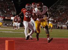 Scott Sommerdorf  |  The Salt Lake Tribune              USC Trojans tight end Randall Telfer scores a 23-yard touchdown with Utah Utes defensive back Ryan Lacy trailing the play.