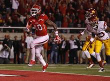 Scott Sommerdorf  |  The Salt Lake Tribune              Utah Utes wide receiver DeVonte Christopher (10) scores on an 18-yard TD catch against USC on Oct. 4, 2012.