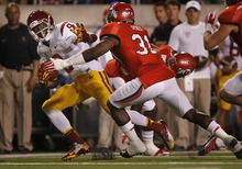 Scott Sommerdorf  |  The Salt Lake Tribune              USC Trojans wide receiver Marqise Lee (9) tries to stiff-arm Utah Utes linebacker Victor Spikes (31) after a catch during first-half play on Oct. 4, 2012, in Salt Lake City.