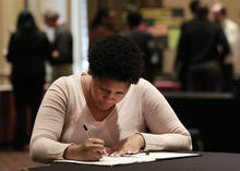 In this Wednesday, Oct. 3, 2012, photo, job hunter Bessie Soley, of Locust Grove, Ga.,  files out an application at the National Job Fair in Atlanta. The number of Americans seeking unemployment benefits rose to a seasonally adjusted 367,000, a level consistent with only modest hiring on Wednesday, Oct. 4, 2012. The Labor Department says applications increased last week by 4,000 from the previous week's level of 363,000. (AP Photo/John Bazemore)