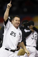 FILE - In this Sept. 30, 2008, file photo, Chicago White Sox's Jim Thome (25) celebrates after their 1-0 win over the Minnesota Twins in a baseball game for the American League Central title in Chicago. John Danks pitched eight innings of two-hit ball, and Thome hit a 461-foot home run for Chicago in the seventh for the game's only run. The Associated Press takes a look at the nine one-game playoffs in major league history. (AP Photo/Charles Rex Arbogast, File)