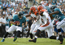 FILE - This Sept. 30, 2012 filoe photo shows Jacksonville Jaguars quarterback Blaine Gabbert (11) getting sacked by Cincinnati Bengals outside linebacker Manny Lawson (99) and strong safety Taylor Mays (26) as running back Maurice Jones-Drew trails the play during the first half of an NFL football game in Jacksonville, Fla. The Bengals lead the NFL with 17 sacks heading into a game against Miami. (AP Photo/Phelan M. Ebenhack, File)