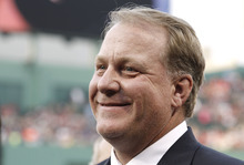 FILE - This Aug. 3, 2012 file photo shows former Boston Red Sox pitcher Curt Schilling smiling after being introduced as a new member of the Boston Red Sox Hall of Fame before the baseball game between the Boston Red Sox and the Minnesota Twins at Fenway Park in Boston. Schilling might have to sell the famed blood-stained sock he wore during the 2004 World Series to cover millions of dollars in loans he guaranteed to his failed video game company. Schilling, whose Providence-based 38 Studios filed for bankruptcy in June, listed the sock as collateral to a bank in a September filing with the Massachusetts Secretary of State. (AP Photo/Winslow Townson, File)