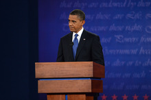 President Barack Obama listens during the first presidential debate with former Massachusetts Governor Mitt Romney at the University of Denver Wednesday, Oct. 3, 2012, in Denver. (AP Photo/The Denver Post, Craig F. Walker) MAGS OUT; TV OUT; INTERNET OUT