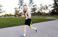 Ashley Detrick  |  The Salt Lake Tribune Jim Michie, 74, runs one of his last training runs around Liberty Park on Wednesday, Oct. 3, 2012, in preparation for the St. George Marathon this weekend. His three mile run around the park was at his marathon pace of 9:09, which will put him finishing right around 4 hours. This marathon will be Michie's 50th since he started running 34 years ago.