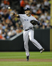 New York Yankees shortstop Derek Jeter (2) throws to first to get out Baltimore Orioles' Taylor Teagarden (31) during the seventh inning of a baseball game, Saturday, Sept. 8, 2012, in Baltimore. The Orioles won 5-4. (AP Photo/Nick Wass)