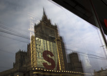 The Russian Foreign Ministry headquarters seen reflected in a shop window in Moscow on Thursday, Oct. 4, 2012.  US prosecutors allege that naturalized U.S. citizen  Alexander Fishenko and six others