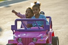 Chris Detrick  |  The Salt Lake Tribune Lily Winchester, 4, and her brother Henry, 2, ride around in her Barbie power wheels at their home in Draper Friday September 21, 2012.