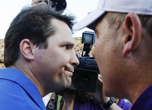 AP file photo Florida coach Will Mushcamp, left, grimaces as he congratulates LSU coach Les Miles after the Tigers defeated the Gators 41-11 last year.