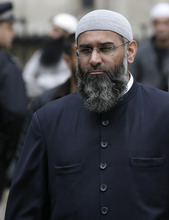 Anjem Choudary, Islamist spokesman looks on  during a protest outside The Royal Courts of Justice in London Friday, Oct. 5, 2012.  Britain's High Court is set to rule Friday afternoon on whether radical cleric Abu Hamza al-Masri and four other terrorist suspects can be extradited to the United States — judgments the government hopes will clear the final hurdle to their removal after years of legal wrangling. J (AP Photo/Kirsty Wigglesworth)