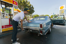Motorist Tony Klein fills up his 1967 Cutlass V-8 at a gas station in Los Angeles Thursday, Oct. 4, 2012. Motorists in California paid an average of $4.232 per gallon Wednesday. That's 45 cents higher than the national average and exceeded only by Hawaii among the 50 states. (AP Photo/Damian Dovarganes)