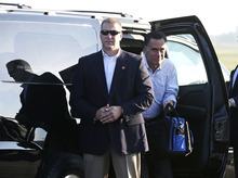 Republican presidential candidate, former Massachusetts Gov. Mitt Romney gets out of his vehicle before boarding his campaign plane at Weyers Cave-Shenandoah Valley Airport in Weyers Cave, Va., Friday, Oct. 5, 2012. (AP Photo/Charles Dharapak)