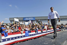 Republican presidential candidate, former Massachusetts Gov. Mitt Romney campaigns at Carter Machinery in Abingdon, Va., Friday, Oct. 5, 2012. (AP Photo/Charles Dharapak)