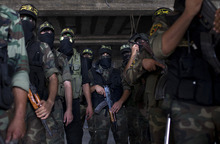 Islamic Jihad militants wait to perform on a stage during celebrations to mark the 25th anniversary of the movement in Gaza City, Thursday, Oct. 4, 2012.  (AP Photo/Bernat Armangue)