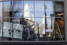 Al Hartmann  |  The Salt Lake Tribune Deseret Book employees in the City Creek Center work on their front window display  March 20.