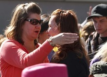 Leah Hogsten  |  The Salt Lake Tribune Kathy Newbold, left, and Lani Allen hug during a memorial and dedicatory service, to their children Friday, October 5 2012 in West Jordan. West Jordan Elementary School students, teachers and staff joined members of the community in a memorial ceremony for two West Jordan Elementary students who passed away recently. A tree, memorial bench and plaques were dedicated for Sierra Newbold and Daniel Allen outside at the school.