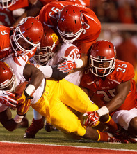 Trent Nelson  |  The Salt Lake Tribune Utah linebacker Trevor Reilly (9), defensive tackle Niasi Leota (93) and linebacker Reshawn Hooker (35) are unable to stop USC's Silas Redd from scoring during a game Oct. 4, 2012 at Rice-Eccles Stadium in Salt Lake City.