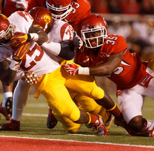Trent Nelson  |  The Salt Lake Tribune Utah linebacker Reshawn Hooker (35) is unable to stop USC's Silas Redd from scoring a first-quarter touchdown during a game Oct. 4, 2012 at Rice-Eccles Stadium in Salt Lake City.