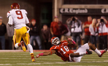 Trent Nelson  |  The Salt Lake Tribune Utah defensive back Eric Rowe (18) falls as USC's Marqise Lee runs for a touchdown Oct. 4, 2012 at Rice-Eccles Stadium in Salt Lake City.