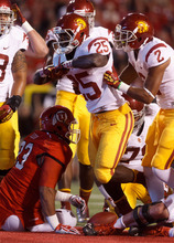 Trent Nelson  |  The Salt Lake Tribune USC's Silas Redd celebrates a first-quarter touchdown over Utah defensive tackle Niasi Leota (93) during a game Oct. 4, 2012 at Rice-Eccles Stadium in Salt Lake City.