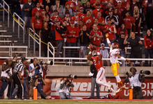 Trent Nelson  |  The Salt Lake Tribune Utah wide receiver Kenneth Scott (2) pulls in a pass in the end zone, ruled at first incomplete then on further review a touchdown, during a game Oct. 4, 2012 at Rice-Eccles Stadium in Salt Lake City.