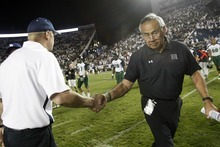 Chris Detrick  |  The Salt Lake Tribune Brigham Young Cougars head coach Bronco Mendenhall and Hawaii Warriors head coach Norm Chow shake hands after the game at LaVell Edwards Stadium Friday September 28, 2012. BYU won the game 47-0.