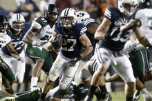 Chris Detrick  |  The Salt Lake Tribune Brigham Young Cougars running back David Foote (27) runs the ball during the second half of the game at LaVell Edwards Stadium Friday September 28, 2012. BYU won the game 47-0.