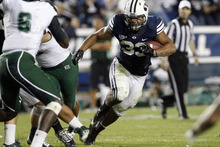 Chris Detrick  |  The Salt Lake Tribune Brigham Young Cougars running back Paul Lasike (33) runs the ball past Hawaii Warriors linebacker Darryl McBride Jr. (6) during the second half of the game at LaVell Edwards Stadium Friday September 28, 2012. BYU won the game 47-0.