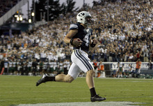 Chris Detrick  |  The Salt Lake Tribune BYU quarterback Taysom Hill scores a touchdown during the the game against Hawaii at LaVell Edwards Stadium on Sept. 28, 2012.
