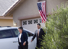 Secretary of Homeland Security Janet Napolitano, left, and Customs and Border Protection Deputy Commissioner David Aguilar exit the home of Border Patrol Agent Nicholas Ivie in Sierra Vista, Ariz. on Friday, Oct. 5, 2012. Ivie was shot and killed earlier in the week. A preliminary investigation has found friendly fire likely was to blame in the shootings of two border agents along the Arizona-Mexico border, the FBI said Friday. (AP Photo/The Arizona Republic, David Wallace)  MARICOPA COUNTY OUT; MAGS OUT; NO SALES