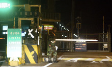South Korean soldiers stand guard at a traffic control gate near the truce village of Panmunjom, in the demilitarized zone that separates the two Koreas, in Paju, north of Seoul, South Korea, Saturday, Oct. 6, 2012.  A North Korean soldier killed two of his superiors Saturday and defected to South Korea across the countries' heavily armed border in a rare crossing that prompted South Korean troops to immediately beef up their border patrol, officials said. (AP Photo/Bae Jung-hyun, Yonhap) KOREA OUT