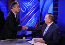 In this Sept. 22, 2010 file photo, Comedy Central's Jon Stewart, left, and Bill O'Reilly tape an interview in New York. Stewart and  O'Reilly, a celebrity odd couple with a history of public political feuds, tangle in a sold-out debate in Washington. The so-called