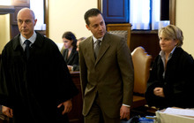 In this photo released by the Vatican newspaper L'Osservatore Romano, the pope's butler Paolo Gabriele, centre, flanked at right by his lawyer Cristiana Arru, leaves the Vatican tribunal, after the verdict, at the Vatican, Saturday, Oct. 6, 2012.  The pope's butler was convicted Saturday of stealing the pontiff's private documents and leaking them to a journalist, and was sentenced to 18 months in prison.  (AP Photo/L'Osservatore Romano)