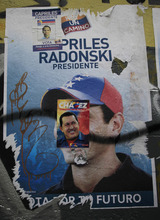 An election campaign sticker promoting Venezuela's President Hugo Chavez covers another in support of opposition presidential candidate Henrique Capriles on a wall in Caracas, Venezuela, Friday, Oct. 5, 2012. Venezuelans head to the polls Sunday to vote in their country's presidential election, deciding on whether to keep Chavez or seek change with opposition candidate Henrique Capriles. (AP Photo/Ariana Cubillos)