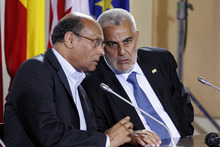 Tunisia's President Moncef Marzouki, left, talks with Morocco's Prime Minister Abdelilah Benkirane during the closing press conference of a Mediterranean summit of southern European and North African countries, in Valletta, Malta, Saturday, Oct. 6, 2012.  The Malta summit of five European and five African nations is expected to focus on fighting terrorism and lawlessness in North African as well as France's push for a military intervention in Mali, where Islamist rebels have taken control in the north. (AP Photo/Andrew Medichini)