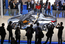 Visitors take snapshots of the BMW i8 concept car, at the end of the first week of the Paris Auto Show, Saturday Oct. 6, 2012.(AP Photo/Remy de la Mauviniere)