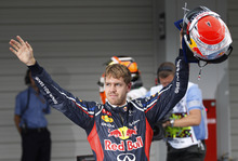Red Bull driver Sebastian Vettel of Germany celebrates after winning the qualifying session for the Japanese Formula One Grand Prix at the Suzuka Circuit in Suzuka, Japan, Saturday, Oct. 6, 2012. (AP Photo/Mark Baker)