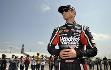 NASCAR driver Kasey Kahne stands next to his car after his qualifying attempt at Talladega Superspeedway in Talladega, Ala., Saturday, Oct. 6, 2012. Kahne took to the pole with a speed of 191.455 mph. for Sunday's NASCAR Sprint Cup Series auto race. (AP Photo/Rainier Ehrhardt)