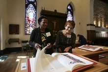 Kim Raff   The Salt Lake Tribune (left) Clarence Bynum and Marge Tucker look through Pentateuch one of the book of the reproduction of the St. John's Bible on display at the Cathedral Church of St. Mark in Salt Lake City on Oct. 3, 2012. The Bible was produced by St. John's Abbey and University, Collegeville, Minn. Renowned calligrapher Donald Jackson and a team of fellow artists and scribes were commissioned to produce this handwritten, hand-illuminated Bible whose seven volumes measure two feet high and three feet wide when opened.