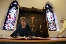 Kim Raff   The Salt Lake Tribune Diane Gooch looks through the Wisdom Books of the reproduction of the St. John's Bible on display at the Cathedral Church of St. Mark in Salt Lake City on Oct. 3, 2012.