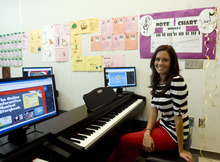 Kim Raff | The Salt Lake Tribune Cassie Olsen-Taylor is the school's program coordinator for the U Play Piano program, an interactive program featuring stories and games that helps students learn to play the piano at Washington Elementary School in Salt Lake City.