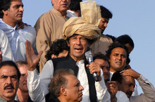 Pakistan's ex-cricket star-turned-politician Imran Khan, center, addresses his supporters during a peace march in Tank, Pakistan on Sunday, Oct. 7, 2012. The Pakistani military blocked a convoy carrying thousands of Pakistanis and a small contingent of U.S. anti-war activists protesting American drone strikes from entering a lawless tribal region along the border with Afghanistan. (AP Photo/I.A Mahsud)