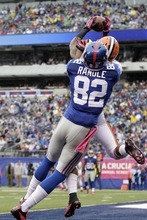 Cleveland Browns defensive back Buster Skrine (22) defends a pass to New York Giants wide receiver Rueben Randle (82)during the first half of an NFL football game Sunday, Oct. 7, 2012, in East Rutherford, N.J. (AP Photo/Kathy Willens)