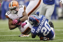 New York Giants defensive back Prince Amukamara (20) tackles Cleveland Browns wide receiver Jordan Norwood (10) during the first half of an NFL football game Sunday, Oct. 7, 2012, in East Rutherford, N.J. (AP Photo/Kathy Willens)