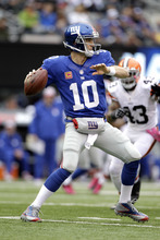 New York Giants quarterback Eli Manning looks to pass against the Cleveland Browns during the second half of an NFL football game Sunday, Oct. 7, 2012, in East Rutherford, N.J. (AP Photo/Kathy Willens)