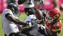 Kansas City Chiefs running back Jamaal Charles (25) fumbles while being tackled by Baltimore Ravens strong safety Bernard Pollard (31) and linebacker Courtney Upshaw (91) during the first half of an NFL football game at Arrowhead Stadium in Kansas City, Mo., Sunday, Oct. 7, 2012. (AP Photo/Colin E. Braley)