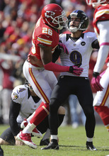 Baltimore Ravens kicker Justin Tucker (9) is run into by Kansas City Chiefs cornerback Stanford Routt (26) after making a field goal during the second half of an NFL football game at Arrowhead Stadium in Kansas City, Mo., Sunday, Oct. 7, 2012. (AP Photo/Ed Zurga)