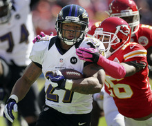 Baltimore Ravens running back Ray Rice (27) is tackled by Kansas City Chiefs cornerback Stanford Routt (26) during the first half of an NFL football game at Arrowhead Stadium in Kansas City, Mo., Sunday, Oct. 7, 2012. (AP Photo/Colin E. Braley)